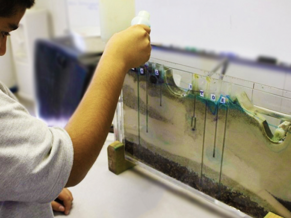 Students using groundwater model